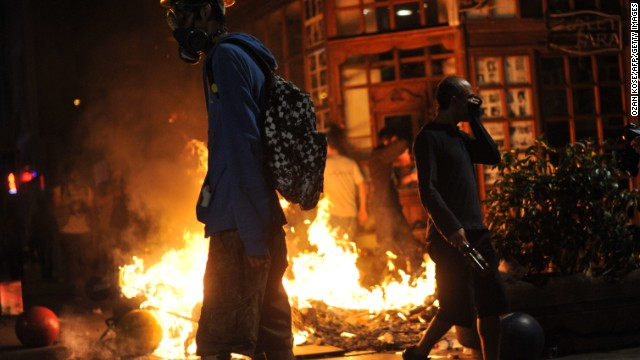 Protestors clash with Turkish riot policemen on September 15, 2013, at Kadikoy in Istanbul.