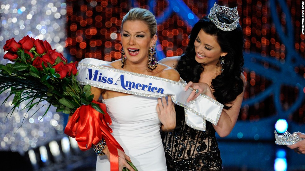 Miss America 2012 Laura Kaeppeler, right, wraps  the sash around Mallory Hytes Hagan of New York, the new Miss America during the 2013 Miss America Pageant at PH Live at Planet Hollywood Resort & Casino on January 12, 2013 in Las Vegas.