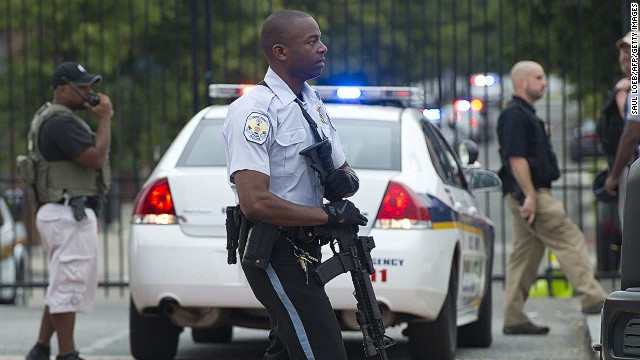 Police respond to the report of a shooting at the Navy Yard in Washington, DC, September 16, 2013