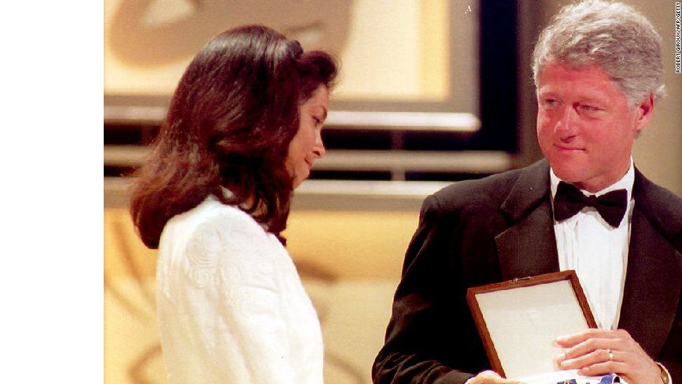 Ashe's widow Jeanne receives the Presidential Medal of Freedom from Bill Clinton on behalf of her late husband in June 1993.