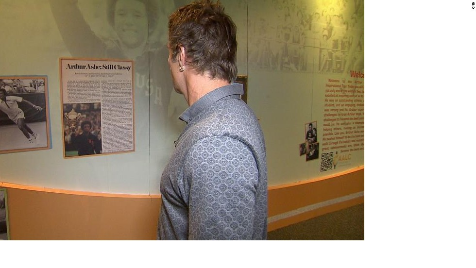 Fellow tennis great Pat Cash examines exhibits in the Arthur Ashe Learning Center in New York which highlight the life and works of the grand slam champion.