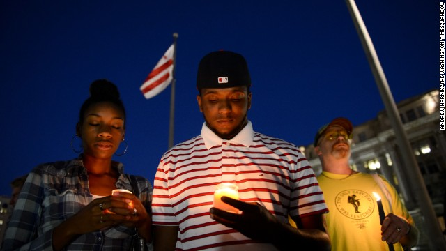Image #: 24360918    Brittany Carter, left, and Jibri Johnson [cq] of Bowie, Md., center, and Bryan Beard of Washington, D.C. attend a candlelight vigil at Freedom Plaza for the victims of the Navy Yard shooting organized by Project End Gun Violence, Washington, D.C., Monday, September 16, 2013. (Andrew Harnik/The Washington Times)     The Washington Times /Landov