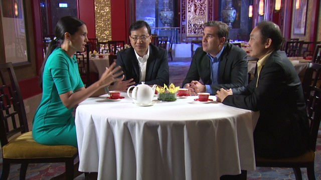 Host Kristie Lu Stout sits with guests from left to right, David Wei, Oliver Rust and Yu Gang.