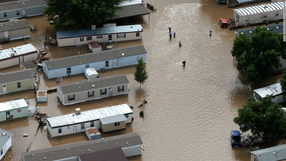 People wade through floodwater in Greeley, Colorado, on September 16.