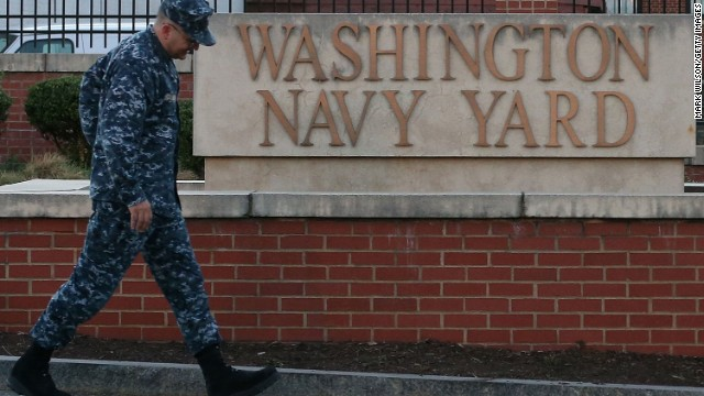 WASHINGTON, DC - SEPTEMBER 17: A member of the military arrives for work at the front gate of the Washington Naval Yard September 17, 2013 in Washington, DC. Yesterday 13 people were shot and killed by a lone gunman during a shooting rampage at the Navy Yard before police killed the gunman.  (Photo by Mark Wilson/Getty Images)
