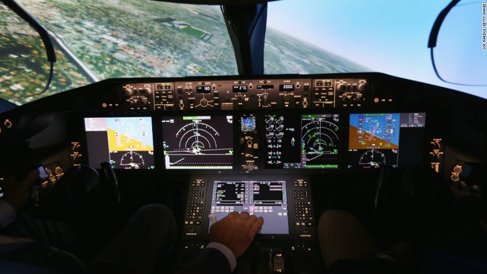 Pilots train on one of two 787 full-flight simulators, like the one shown here, at the company's training center in Miami. Capt. Gary Lee Beard is shown demonstrating one of the simulators.