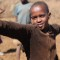 Africa Yoga Project Maasai child warrior pose