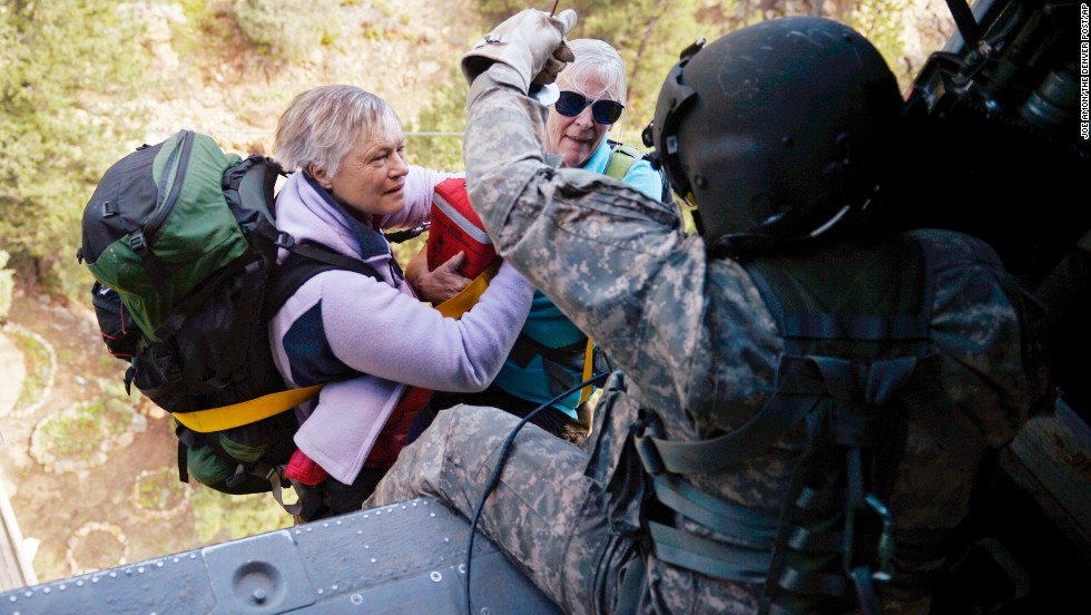 Two women are hoisted into a Blackhawk helicopter during a search and rescue mission near Jamestown, Colorado, on September 17.