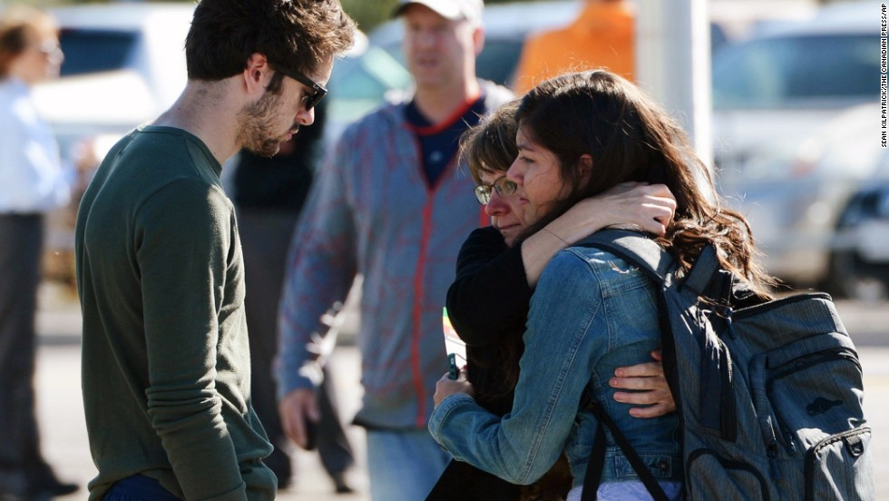 People comfort one another after the crash on September 18.