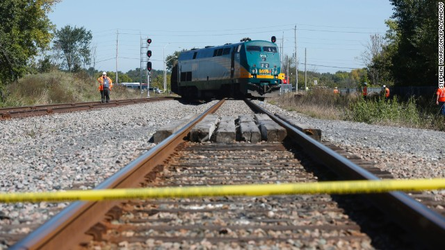 The train sits derailed as officials work at the scene of the crash on September 18.