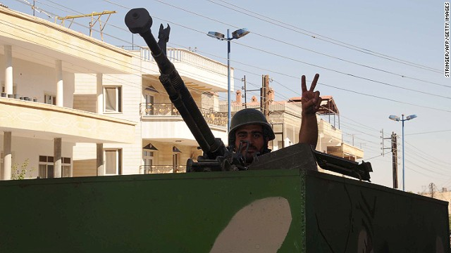 A Syrian soldier flashes the V for 'victory' sign as he mounts a machine gun in the Syrian Christian town of Maalula on September 7, 2013