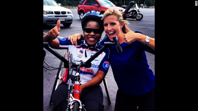 "Daniel celebrates riding 26 miles for ""Ride 2 Recovery"" with CNN's Poppy Harlow."