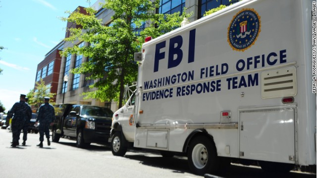 In this handout image provided by the U.S. Navy, An F.B.I. evidence response team collects evidence on September 18, 2013 at Building 197 at the Washington Navy Yard in Washington, DC. Defense contractor Aaron Alexis allegedly shot and killed 12 people at the base on September16.