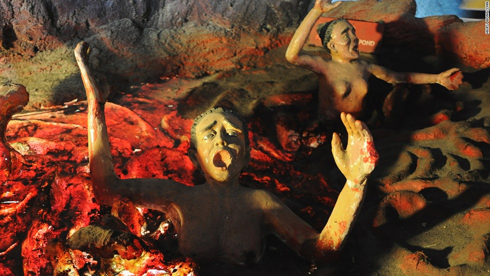An unusual family theme park, Haw Par Villa portrays the gruesome tortures in hell. This woman roasting in a volcanic pit is either a con artist, a thief or has inflicted physical injury upon others, according to the exhibit's inscription.