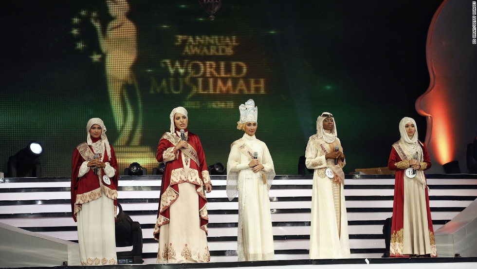 Women speak on stage during the competition.