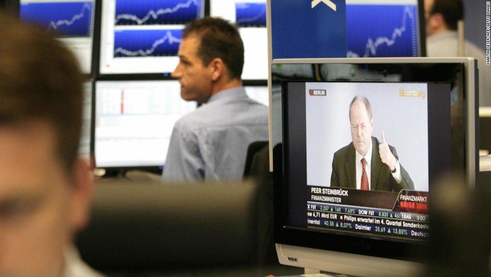As finance minister of the Eurozone's largest economy, Steinbrueck was the mastermind behind Germany's bank rescue plan. Here, traders at the Frankfurt stock exchange listen to a statement by Steinbrueck during the financial crisis in October 2008.
