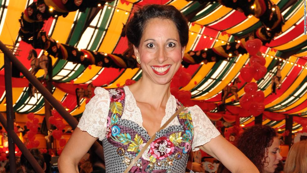 A tent isn't just a tent at Oktoberfest, but a sign of your personality type. Celebrities of various grades gather at the Hippodrom tent -- here a German designer of trad Bavarian wears what looks like a floral spaceship landing on her head.