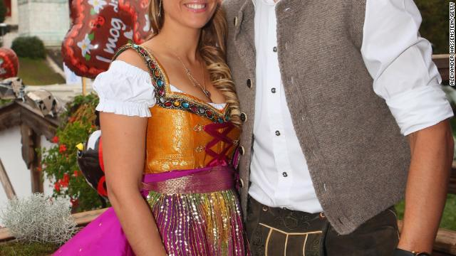 Married to a large professional football player (Daniel van Buyten) this Oktoberfest lady is no doubt wearing her dirndl bow to the right.