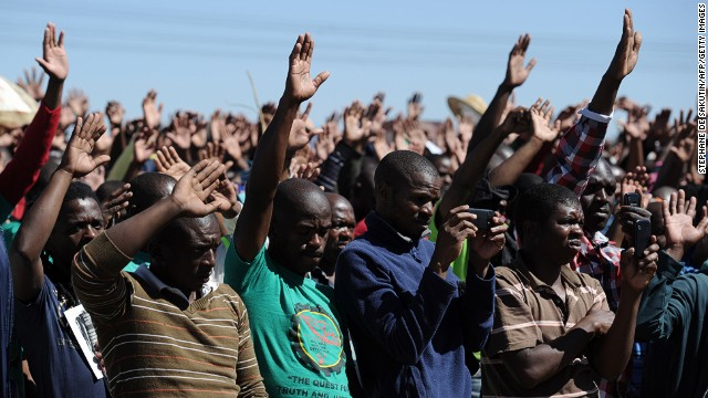 Co-workers of the 34 miners shot dead by South African police during a violent wage strike attend a ceremony to mark the first anniversary of their deaths on August 16, 2013 in Marikana.