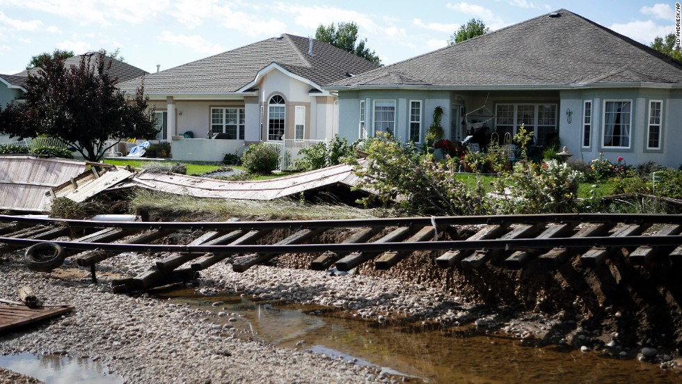 Railroad tracks washed from their path by floodwaters are seen in Longmont on Thursday, September 19, 2013.  Massive flooding has left at least six people dead and damaged thousands of homes around the state.