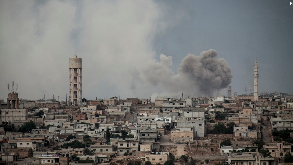 Smoke rises after a bomb was thrown from a helicopter, hitting a rebel position during heavy fighting between troops loyal to Syrian President Bashar al-Assad and opposition fighters in the Idlib province on September 19.