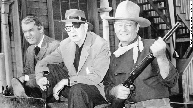 Jimmy Stewart, director John Ford and John Wayne appear on the set of 'The Man Who Shot Liberty Valance' in 1962.