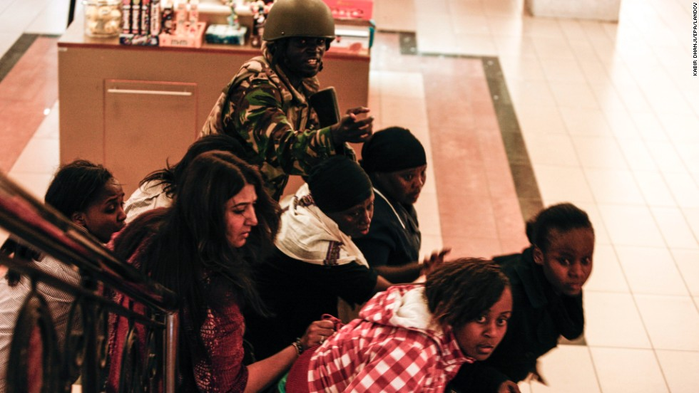 A soldier directs people up a stairway inside the Westgate on September 21.