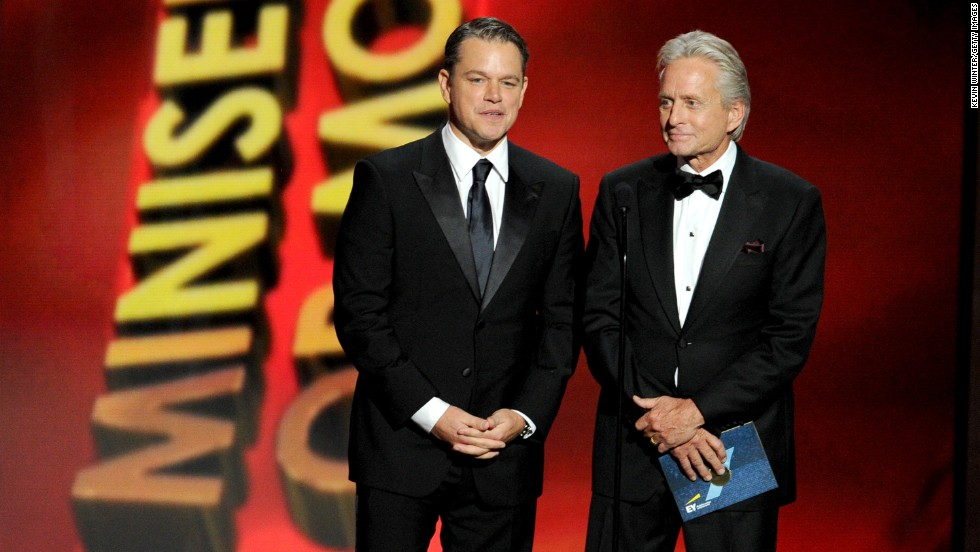 """Behind the Candelabra"" stars Matt Damon, left, and Michael Douglas take the stage."