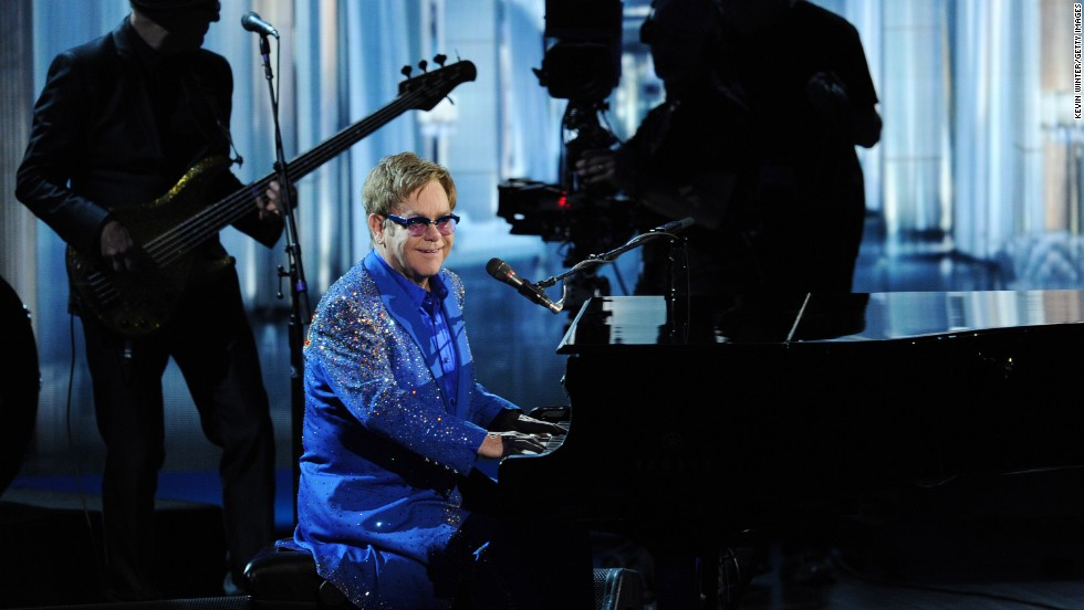 Elton John pays tribute to Liberace during his performance at the Emmys.