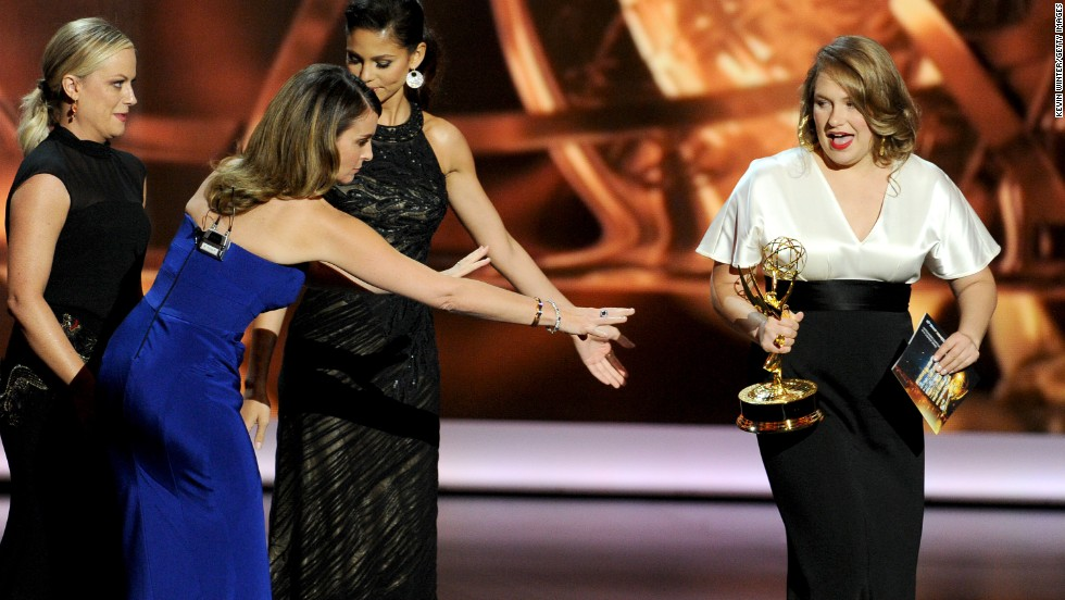 "Merritt Wever of ""Nurse Jackie,"" right, accepts the award for outstanding supporting actress in a comedy series."