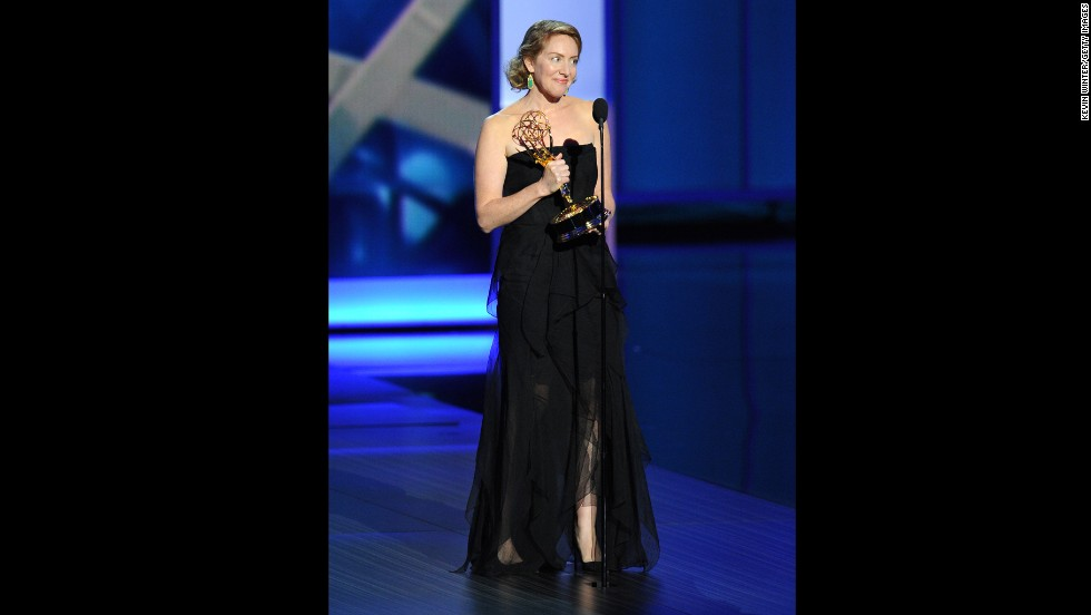 """Outstanding writing for a drama series: Sarah Bromell accepts the award for her late husband, Henry Bromell, """"Homeland"""""""