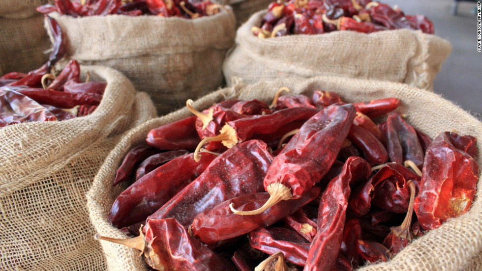 """Red, green, or Christmas? That's New Mexico parlance for """"How do you prefer your chile?"""" Here, sacks of dried red chile pods are displayed in Hatch, New Mexico, the self-proclaimed """"Chile Capital of the World."""""""