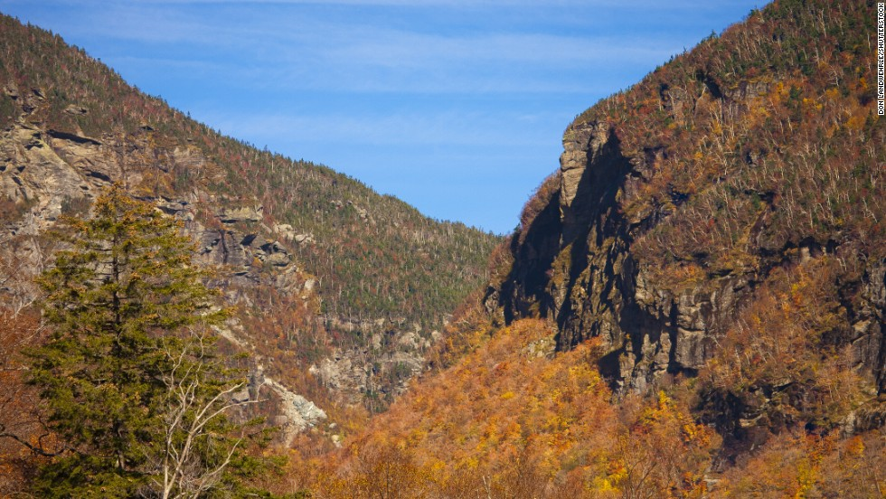 As part of our recommended drive through Vermont's ever-changing fall foliage season, you can enjoy a lovely view of Smuggler's Notch from Stowe, Vermont.
