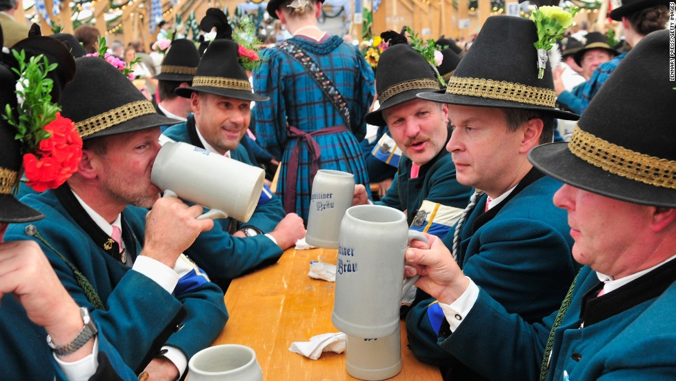 Men dressed in traditional rifleman uniforms drink together at the festival on Sunday, September 22.