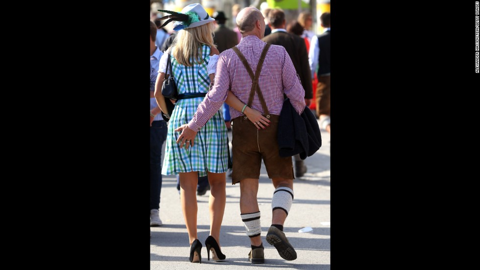 A couple walk around the festival in Munich on September 21.