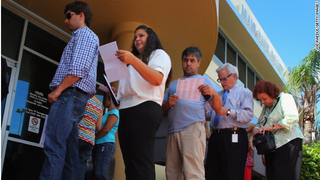 People wait to turn in their voter registration forms to the Miami-Dade, Florida, elections department in October.