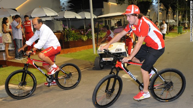Formula One racer Fernando Alonso, right, hasn't ruled out starting his own cycling team.