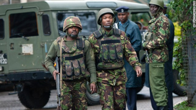 Kenyan army soldiers patrol near the Westgate Mall in Nairobi, Kenya, Tuesday, Sept. 24, 2013. Kenyan security forces battled al-Qaida-linked terrorists in an upscale mall for a third day Monday in what they said was a final push to rescue the last few hostages in a siege that has left at least 62 people dead. (AP Photo/Sayyid Azim)