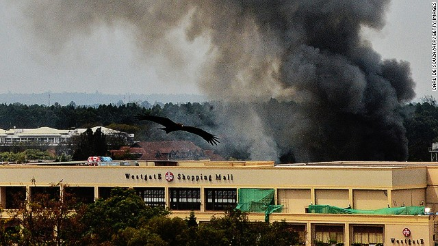 Smoke rises from the Westgate mall in Nairobi on September 23, 2013. Kenyan troops were locked in a fierce firefight with Somali militants inside an upmarket Nairobi shopping mall in a final push to end a siege that has left 43 dead and 200 wounded with an unknown number of hostages still being held. Somalia's Al Qaeda-inspired Shebab rebels said the carnage at the part Israeli-owned complex mall was in retaliation for Kenya's military intervention in Somalia, where African Union troops are battling the Islamists.