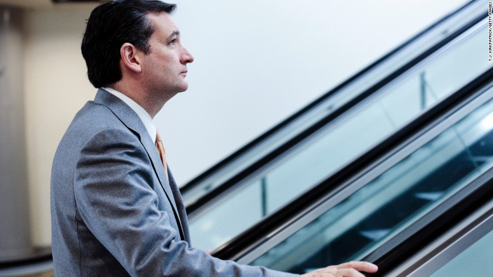 Cruz heads to the weekly Senate Republicans policy luncheon in Washington in March 2013.