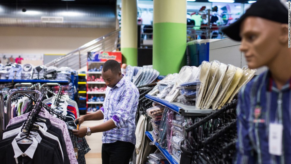 A customer browses men's clothing on display at the Nakumatt department store.