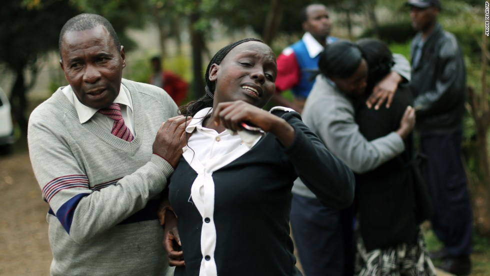 Relatives of Johnny Mutinda Musango, 48, weep after identifying his body at the city morgue  in Nairobi, Kenya, on Tuesday, September 24. Musango was one of the victims of the Westgate Mall hostage siege. Kenyan security forces were still combing the mall on the fourth day of the siege by al Qaeda-linked terrorists.