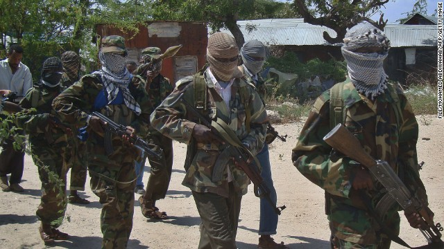 This file photo shows an Al-Qaeda linked al-shabab recruits walk down a street in 2012 in the Deniile district of the Somalian capital, Mogadishu, following their graduation.