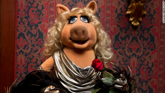 """A Miss Piggy muppet used in """"The Muppet Show,"""" is all dressed up during a ceremony to donate additional Jim Henson objects to the Smithsonian's National Museum of American History in Washington."""
