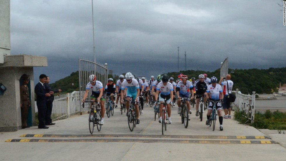 Bikers coming off the bridge over the Tumen River between China and North Korea, the starting point of the race.