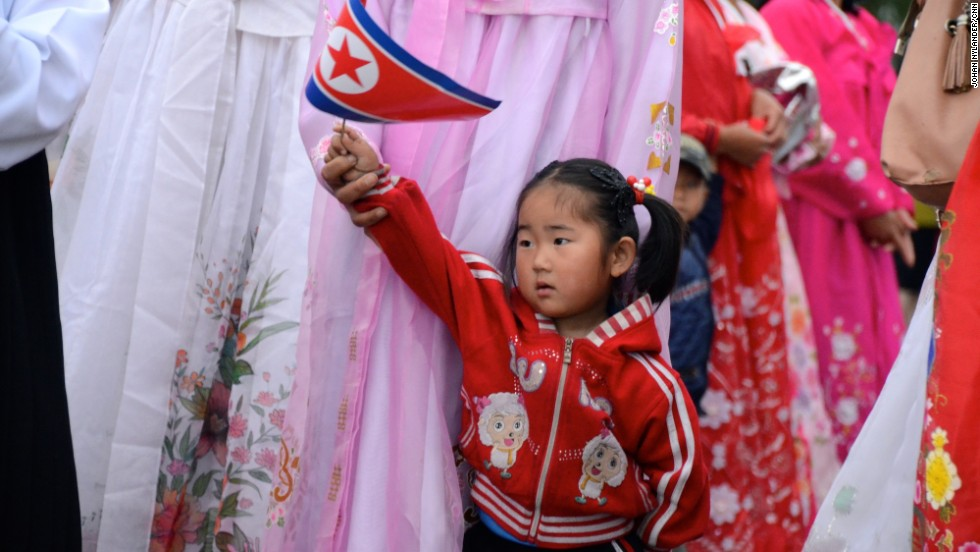 A child with the North Korean flag by the finishing line in Rason.
