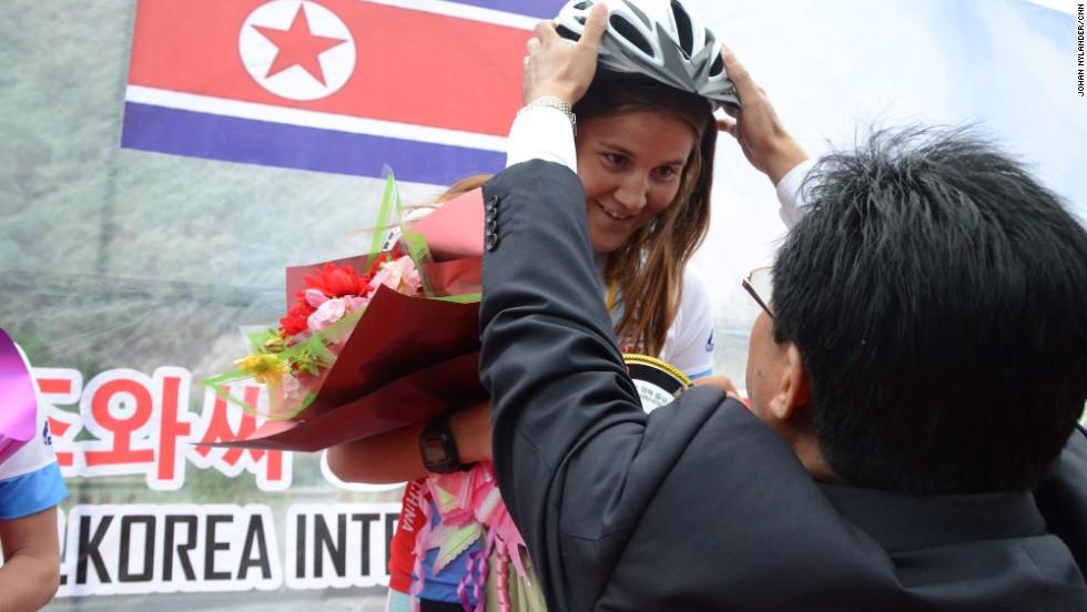 Swedish racer Annie Thorén receives award by Chon Dong Chol, head of the Rason tourism bureau.