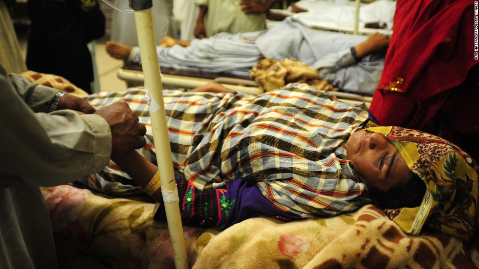 Pakistani relatives help an injured earthquake survivor at a hospital in Karachi on September 25. At least 330 people have died, a spokesman for the National Disaster Management Authority said Wednesday. In addition to the fatalities, 445 people were injured, he said.