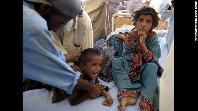 Pakistani child survivors are treated in makeshift hospital in the earthquake-devastated district of Awaran on September 25, 2013.  Desperate villagers in southwest Pakistan clawed through the wreckage of their ruined homes , a day after a huge earthquake struck, killing more than 270 people and creating a new island off the coast.   AFP PHOTO/Banaras KHAN        (Photo credit should read BANARAS KHAN/AFP/Getty Images)