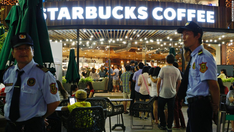 Even in Vietnam, a global coffee capital, customers lined up to be the first to hold a cup sporting the iconic twin-tailed mermaid on the opening day of the first Starbucks outlet in Ho Chi Minh City in February 2013.